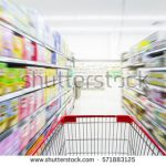 stock-photo-supermarket-aisle-with-empty-red-shopping-cart-571883125