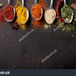 stock-photo-various-spices-spoons-on-stone-table-top-view-with-copy-space-519305314